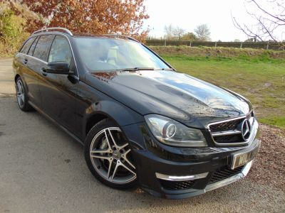 Mercedes-Benz C Class 6.2 C63 5dr Auto (Full Merc SH! Sunroof! +++) Estate Petrol Obsidian Black MetallicMercedes-Benz C Class 6.2 C63 5dr Auto (Full Merc SH! Sunroof! +++) Estate Petrol Obsidian Black Metallic at Williams Group Maidstone