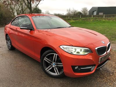 BMW 2 Series 1.5 218i Sport (s/s) 2dr (Leather! Heated Seats! +++) Coupe Petrol Valencia Orange MetallicBMW 2 Series 1.5 218i Sport (s/s) 2dr (Leather! Heated Seats! +++) Coupe Petrol Valencia Orange Metallic at Williams Group Maidstone